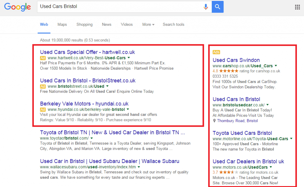 "a screenshot of an Google search for ""used cars Bristol"" with the paid search portions highlighted by a red triangle"