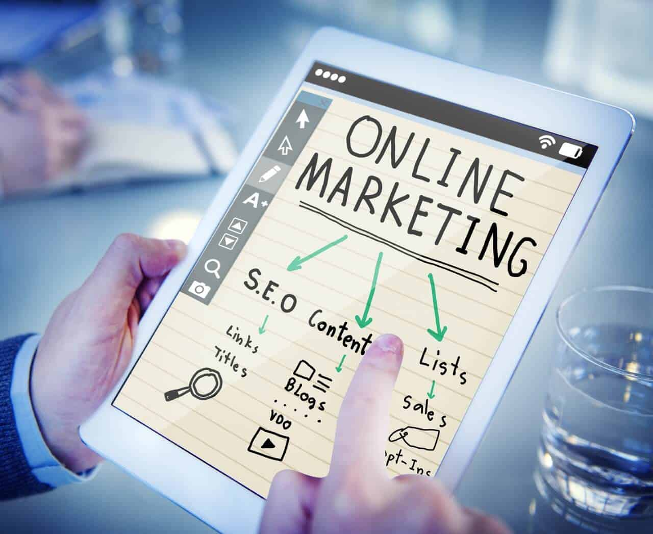 """an image of a tablet with the heading """"online marketing"""" and arrows pointing to SEO, content, and lists"""